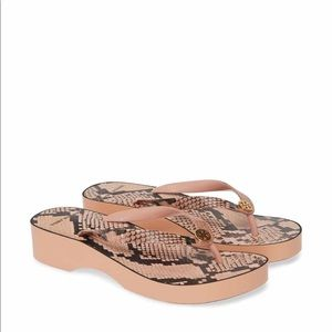 TORY BURCH CUT-OUT WEDGE flip flop.